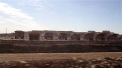 Row of giant dumper lorries - stock footage