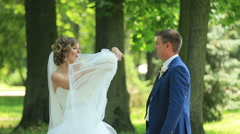 Wedding couple rejoice in the park - stock footage