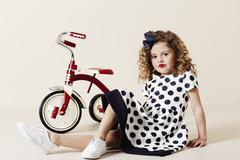Retro girl in spotty dress - stock photo