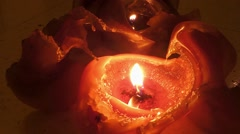 Two orange candles burning down with bizarre wax Stock Footage