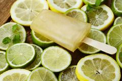 Lemon and lime lolly - stock photo