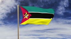 Mozambique flag waving in the wind. Green screen, alpha matte. Loopable Stock Footage