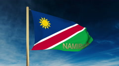 Namibia flag slider style with title. Waving in the wind with cloud background Stock Footage
