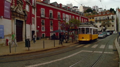 Lisbon - Tram Running Through Alfama Neighborhood Stock Footage