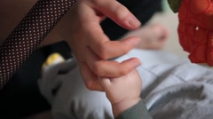 Mama holding her baby's hand Stock Footage