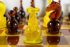 Amber chess pieces - stock photo
