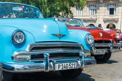 Colorful classic american cars parked in Old Havana Stock Photos