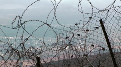 Tangled strands of razor barbed wire Stock Footage