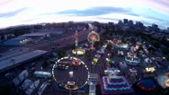 Stock Video Footage of Aerial of Urban Carnival in Early Evening