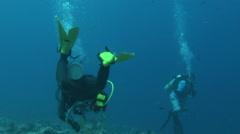 Tourist Scuba Diving at Top Dive Sight Blue Corner - PALAU Stock Footage
