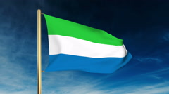 Sierra Leone flag slider style. Waving in the wind with cloud background Stock Footage
