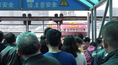 Passengers get on a ferry boat in Shanghai, China Stock Footage
