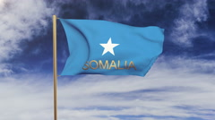 Somalia flag with title waving in the wind. Looping sun rises style.  Animation Arkistovideo