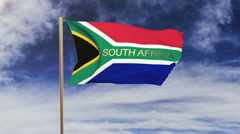 South Africa flag with title waving in the wind. Looping sun rises style Arkistovideo