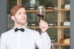 Sommelier testing red wine Stock Photos