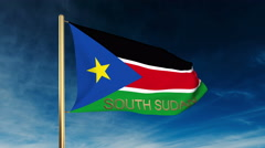 South Sudan flag slider style with title. Waving in the wind with cloud Stock Footage