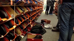 People looking a shoes at shoe store - stock footage