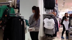 Shopper inside Forever 21 store to buying clothes Stock Footage