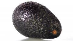 Big avocado turns - stock footage