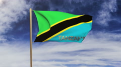 Tanzania flag with title waving in the wind. Looping sun rises style.  Animation Arkistovideo
