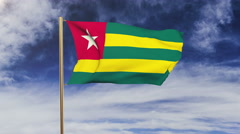 Togo flag waving in the wind. Green screen, alpha matte. Loopable animation Stock Footage