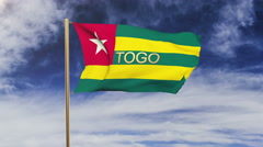 Togo flag with title waving in the wind. Looping sun rises style.  Animation Stock Footage