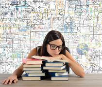 Bored student reads books - stock photo