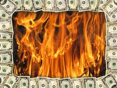 frame from the dollars on the background of flame - stock illustration