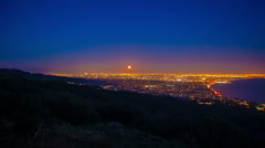 Moonrise over santa monica and LA wide shot Stock Footage