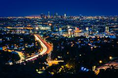 View of the Los Angeles Skyline and Hollywood at night from the Hollywood Bow - stock photo