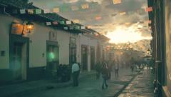 People walking on street at sunset Stock Footage