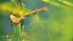 Guitarist silhouette in smoke during concert - stock footage