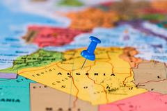 Map of Algeria with a blue pushpin stuck Stock Photos