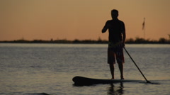 Back lit SUP at Sunrise - stock footage