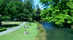 People relaxing in a park, Christchurch, New Zealand Stock Footage