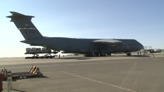 MILITARY C-5 CARGO PLANE AIR FORCE FLEET FOR WAR AT BASE - stock footage