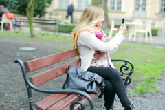 Girl making film on smartphone in the outdoor cafe Stock Footage