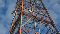 Red and white communication tower. Section. Time lapse. - stock footage