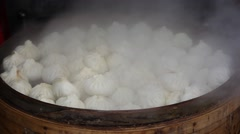 Traditional Chinese steamed buns during cooking Stock Footage