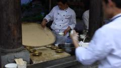 Cooks making Sandapao, so called triple bangs, a famous traditional street food Stock Footage