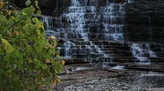 Niagara Escarpment waterfalls pouring down from limestone cliff Stock Footage
