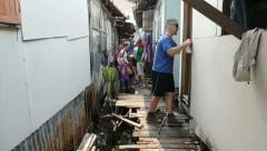 Short-Term Missions Team Prepares To Fix Sidewalk In Slum Stock Footage