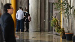 People passing and waiting in a reception of a big building Stock Footage