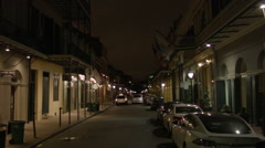 French Quarter New Orleans street with hotel, dark Stock Footage
