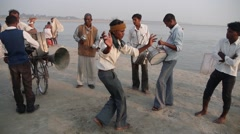 A man dances at Sangam,Allahabad,India Stock Footage
