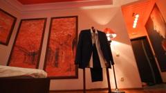 Man's elegants  suits on room slide frame Stock Footage