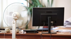 White collar worker coming to office working place wth cooling fan on foreground Stock Footage