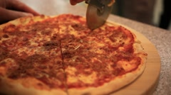 Cutting italian pizza with mushrooms, ham and cheese. Close up. HD. 1920x1080 Stock Footage