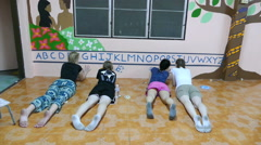 Short-Term Missions Team Painting Wall Mural Together Stock Footage