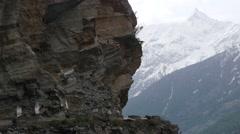 Bus on small road through rocky mountains,Kalpa,Kinnaur,India Stock Footage
